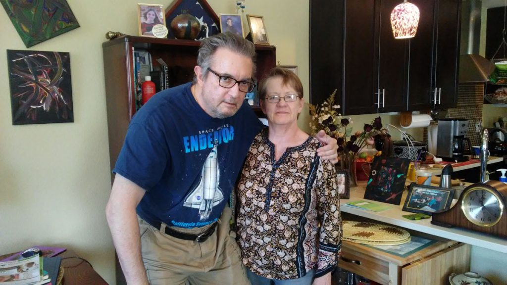 Randy Schiell with his wife, Janelle, in their Denver home.