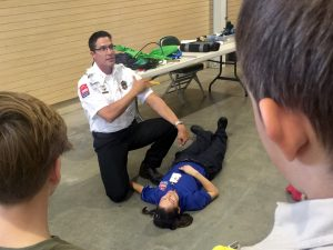 UCHealth Emergency Medical Services deputy chief Braden Applegate desmonstrates how to apply a tourniquet and control bleeding.