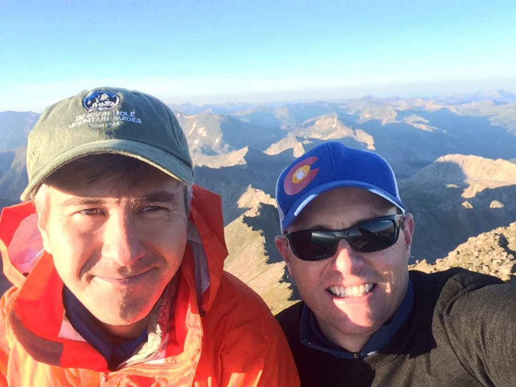 Dr. David Kuwayama helped mount a resuce in Australia for his friend and colleague, Dr. Rob Meguid. Here the two pose for a photo on the summit of Blanca Peak, one of Colorado's 14ers.