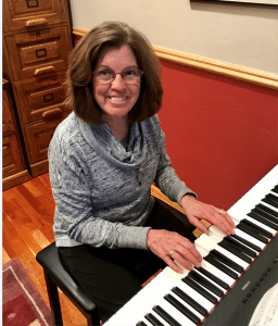 Libby McDermott pictured playing piano | UCHealth