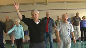 Movement as medicine for Parkinson's. Here, a man leads an exercise class for pepole with Parkinson's.