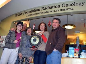 A photo of Kate Prewett with family members after completion of radiation treatment.