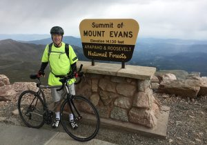 David Brenner on top of Colorado's Mount Evans with his bike, during which time he was battling coronary artery disease..