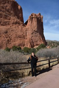 Linda Regis is pictured in front of a red rock in Garden of the Gods Park.
