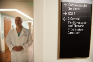 Dr. Peter Walinsky walks through a hallway at UCHealth Memorial Hospital Central.