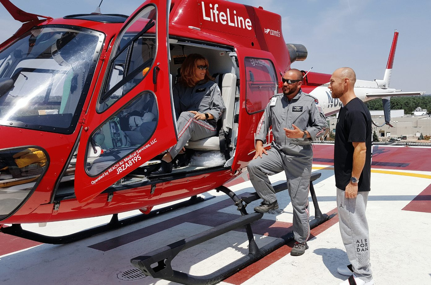UCHealth's Lifeline helicopter is shown with Flight Nurse Ami Bess in the cockpit. She and Matt Bergland, a flight paramedic, talk to patient Eddie Kerr.