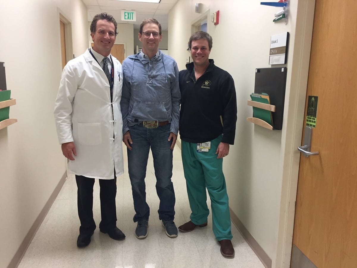 Archie Chant, center, with two of his doctors, Craig Hogan, left, and Jason Stoneback, right.