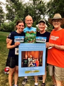 Amy and Scott La Point, left, with Ruthie and Jim Eastman, right, at the 2018 Donor Dash. La Point gave his kidney to Eastman and the men and their families have since bonded.