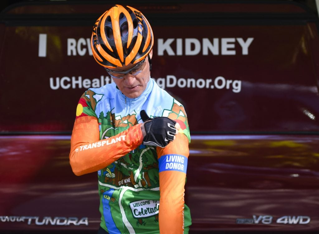 Scott La Point poses in a bike shirt especially made for living organ donors. Photo by Cyrus McCrimmon for UCHealth