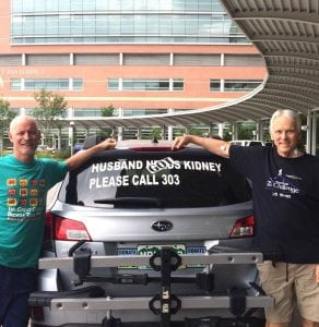 "The photo shows Scott La Point, the kideny donor, standing with his kidney recipient, Jim Eastman. They are posing with the car that had the sign, ""Husband needs Kidney."" It now says Husband Got Kidney."