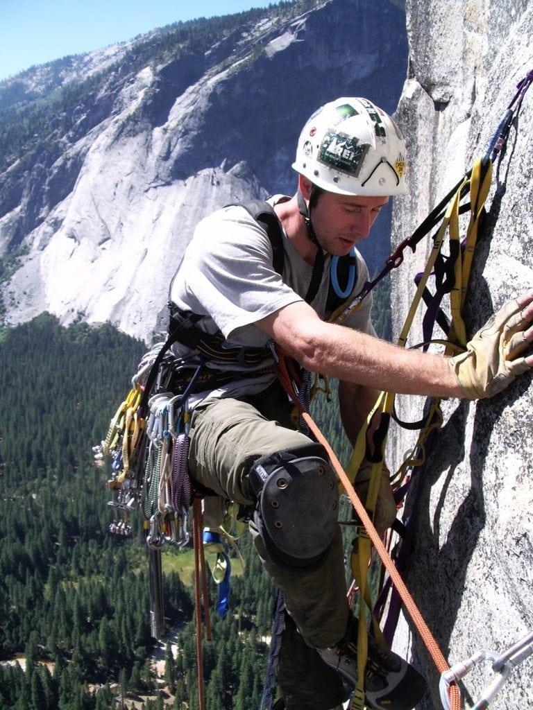 Dr. John Hall rock climbing.