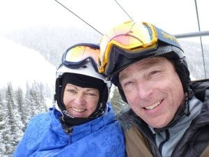 Trisha and Brian Washburn in a photo on a chairlift durign ski season. Both are ski instructors who moved to Colorado from Connecticut so they could ski the biggest mountains.