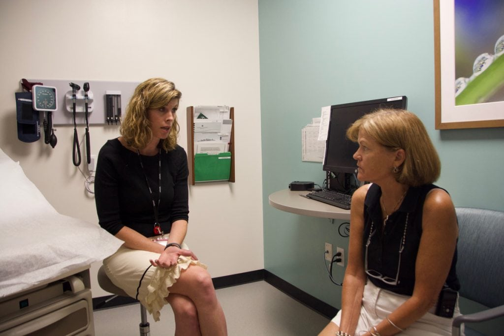 Lauren Tolle, left, a clinical psychologist, meets with patient, Trisha Washburn, right, at the UCHealth Family Medicine Clinic in Westminster. Tolle is helping Washburn cope with anxiety.