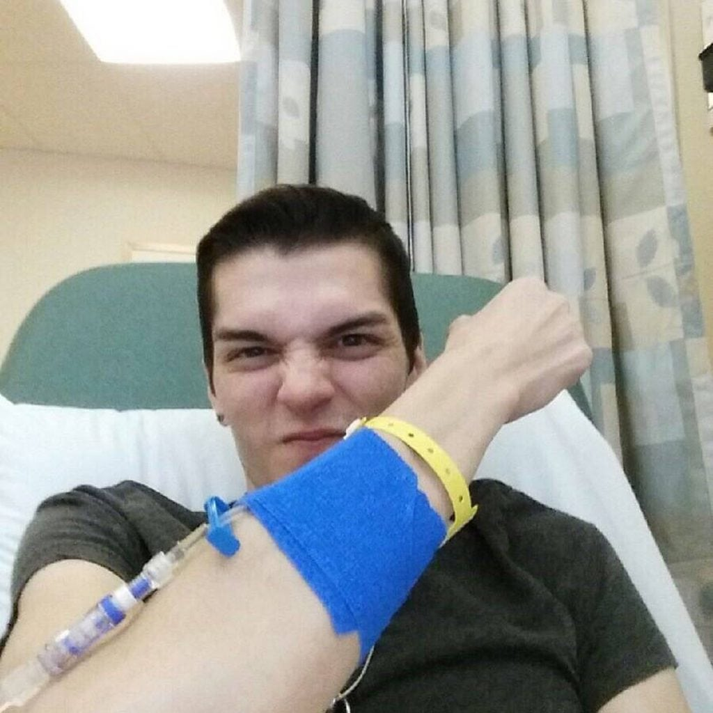 Stephen Estrada holds up his arm defiantly during his first immunotherapy treatment.