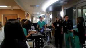 Dr. Jason Brainard, (center), medical director of the Surgical Trauma ICU at UCHealth University of Colorado Hospital, leads morning patient rounds.