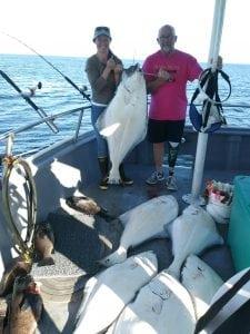 Stephanie and Jesse Adams show off their halibut catch during a recent trip to Alaska. Photo courtesy of Stephanie Adams.