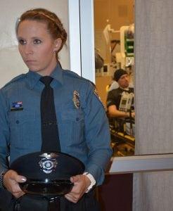 officer stands outside CSPD Officer Duzel room.