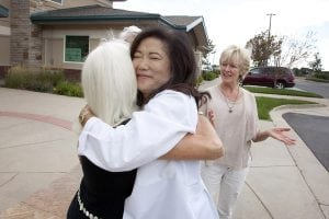 UCHealth internal medicine physician Dr. Cathy Ow embraces her patient of more than 20 years, Lane Oesterle-Miller outside her UCHealth Internal Medicine – Snow Mesa office