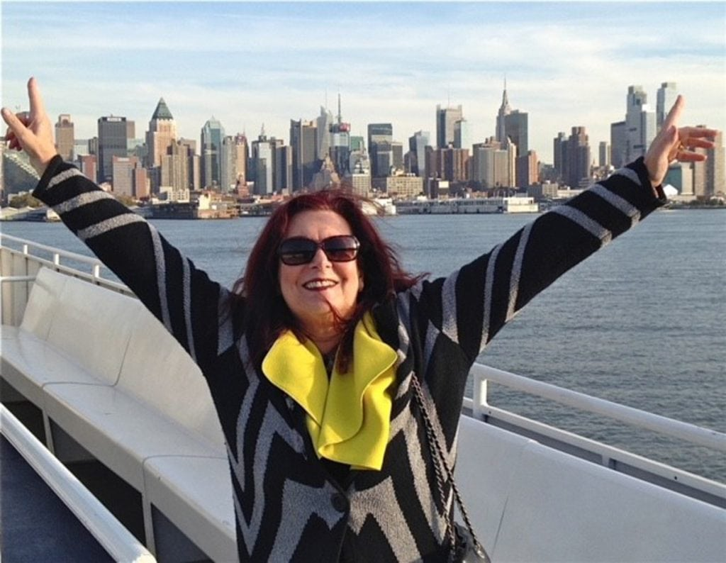 Photo of Barbara Hope-Gaiti, patient with undiagnosed cutaneous lymphoma, with New York City skyline in the background.