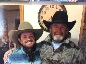 A photo of Nathan Kissack, 30, with his dad. Both are wearing cowboy hats. They run a ranch together in Wyoming.