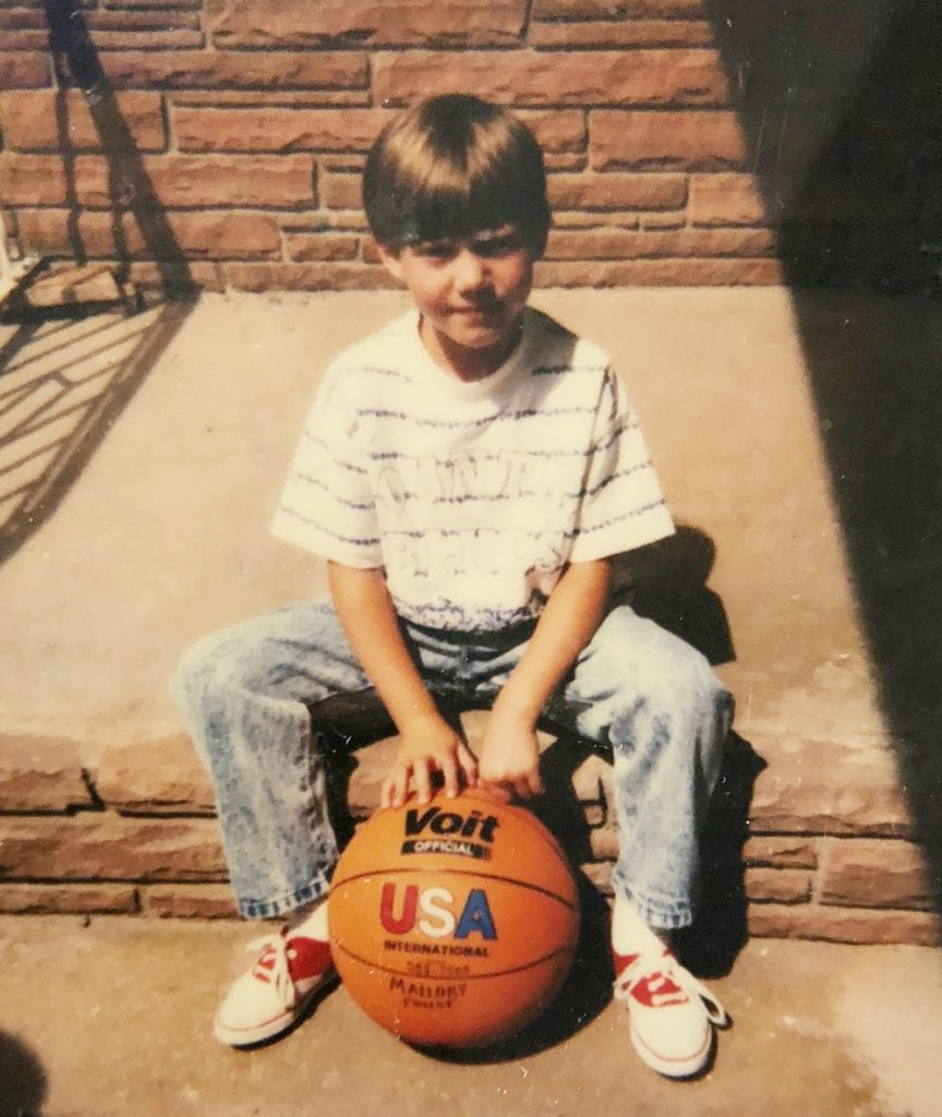 Mal Foust at age 5 sits on his front steps. He was born a girl, but looks very much like a boy in this picture.