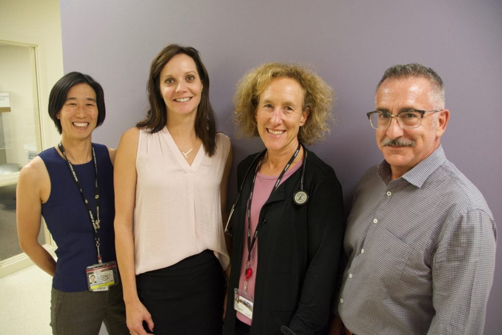 Four doctors pose. They include three women and a man. All provide care for UCHealth's Transgender Program.
