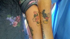 Mickey and Minnie Mouse tattoos on the Alires' forearms are a constant reminder of their connection to one another.