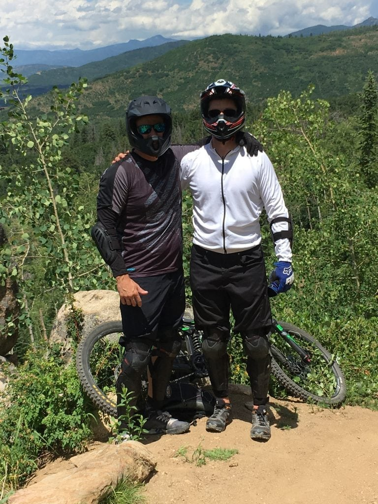 Doug Fashenpour and Brian Makel are shown in mountain biking gear, just before his recovery from spinal cord injury caused by a bike accident.
