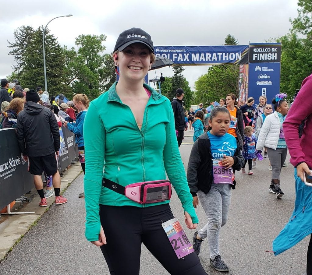 A photo of a woman at the Colfax Marathon in Denver.