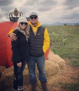 Devyn Brinkerhoff and her fiance, Caleb Olsen, pose together outside.
