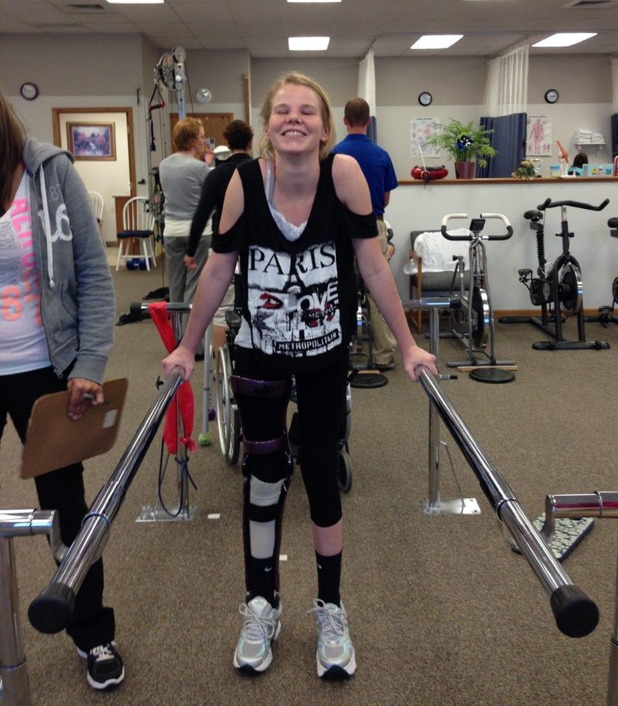 Devyn Brinkerhoff smiles as she learns to walk again.