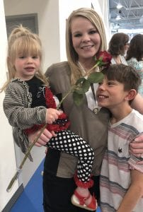 Deveyn Brinkerhoff poses with her niece and nephew.