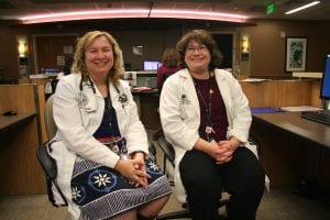 A photo of two advanced practice nurses