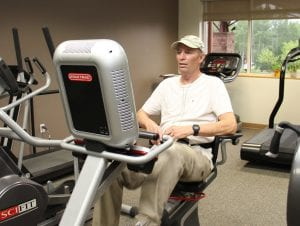 Ken Kolar uses an exercise bike as part of his cardiac rehab.