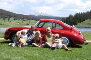 Jerry and Arnette Schouten in Keystone in 2009, with granddaughters (from left) Adleigh, Alexa and Ashlynne. Jerry had recently restored the red Porsche 356. (Courtesy April Hagestad)