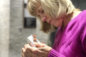 Kathy looks at white ambulance