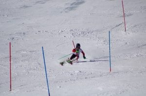 Emi Cooper skis around race poles.