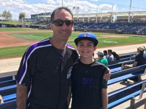 Scott Sarkisian and Son at a baseball field.