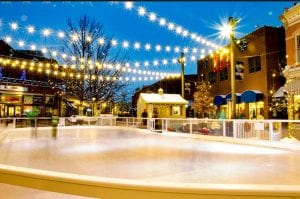 Christmas lights are strung across an empty ice rink in Old Town Fort Collins, one of the top outdoor skating spots..