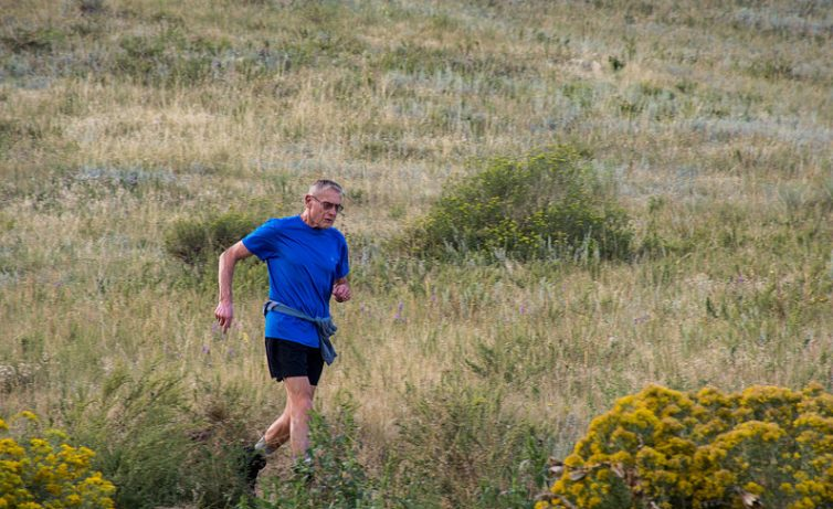 Val Tirman running along a trail in Colorado.
