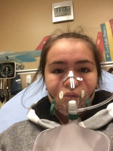Mila Schreder, 11, wears an oxygen mask at the UCHealth Emergency Room - Smoky Hill. Mila, her brother Will, 14, and their parents all had to be treated for carbon monoxide poisoning after a faulty furnace filled their home with the deadly gas. Photo courtesy of Mila Schreder.