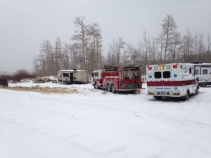 This photo shows emergency response vehicles at the hunter's base camp.