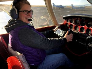 pilot sits in cockpit of small plane