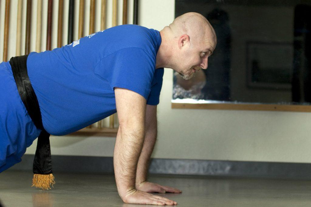 dan in a plank position
