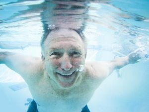 older man's face under water