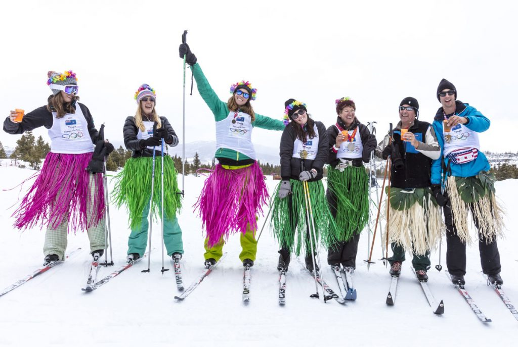 cross-country skiers wear hula skirts during an event at the Frisco Nordic Center.