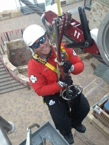 Chris Welch is in a harness connected to the gondola line during a training exercise.