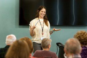 women talking to audience during longmont seniors program