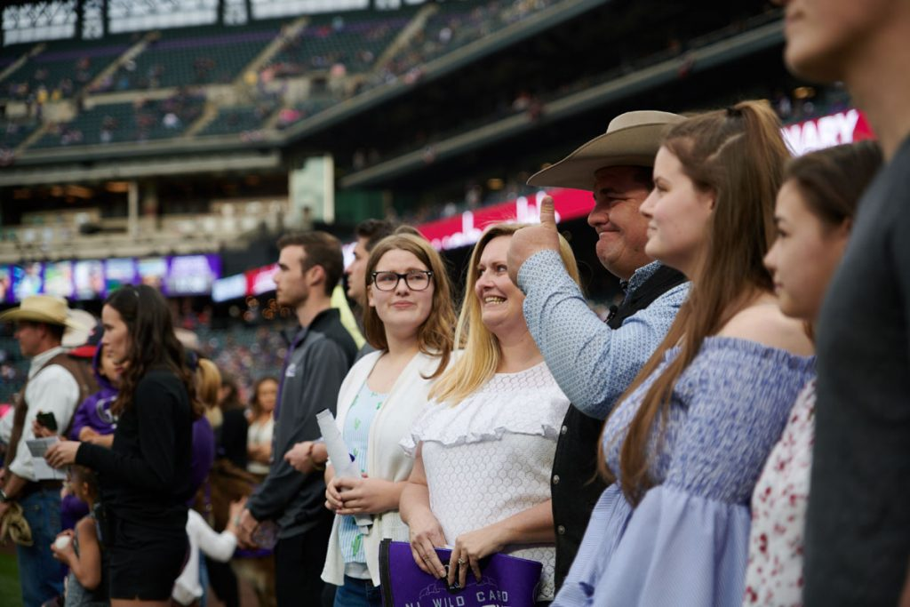 Mike and his family line up for the playing of the national anthem at Coors Field.