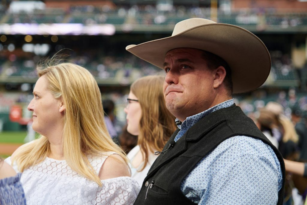 Mike Brashear, with a tear in his eye, on the field of Coors Field.
